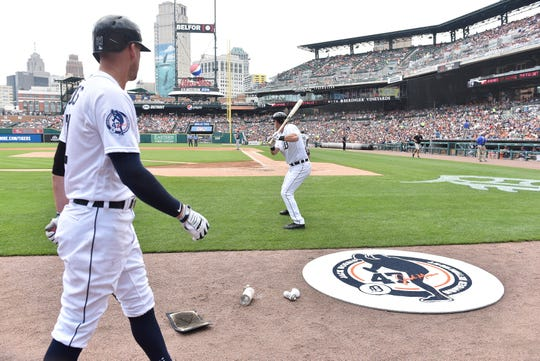 JaCoby Jones, left, and Jim Adduci on deck at Comerica Park.