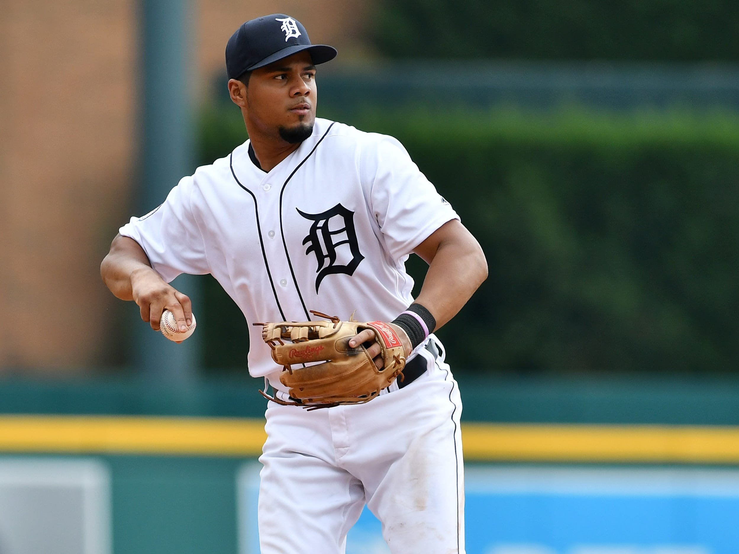 Tigers third baseman Jeimer Candelario about to throw to first for an out in the third inning.   Detroit Tigers vs Minnesota Twins at Comerica Park in Detroit on Aug. 12, 2018. 
