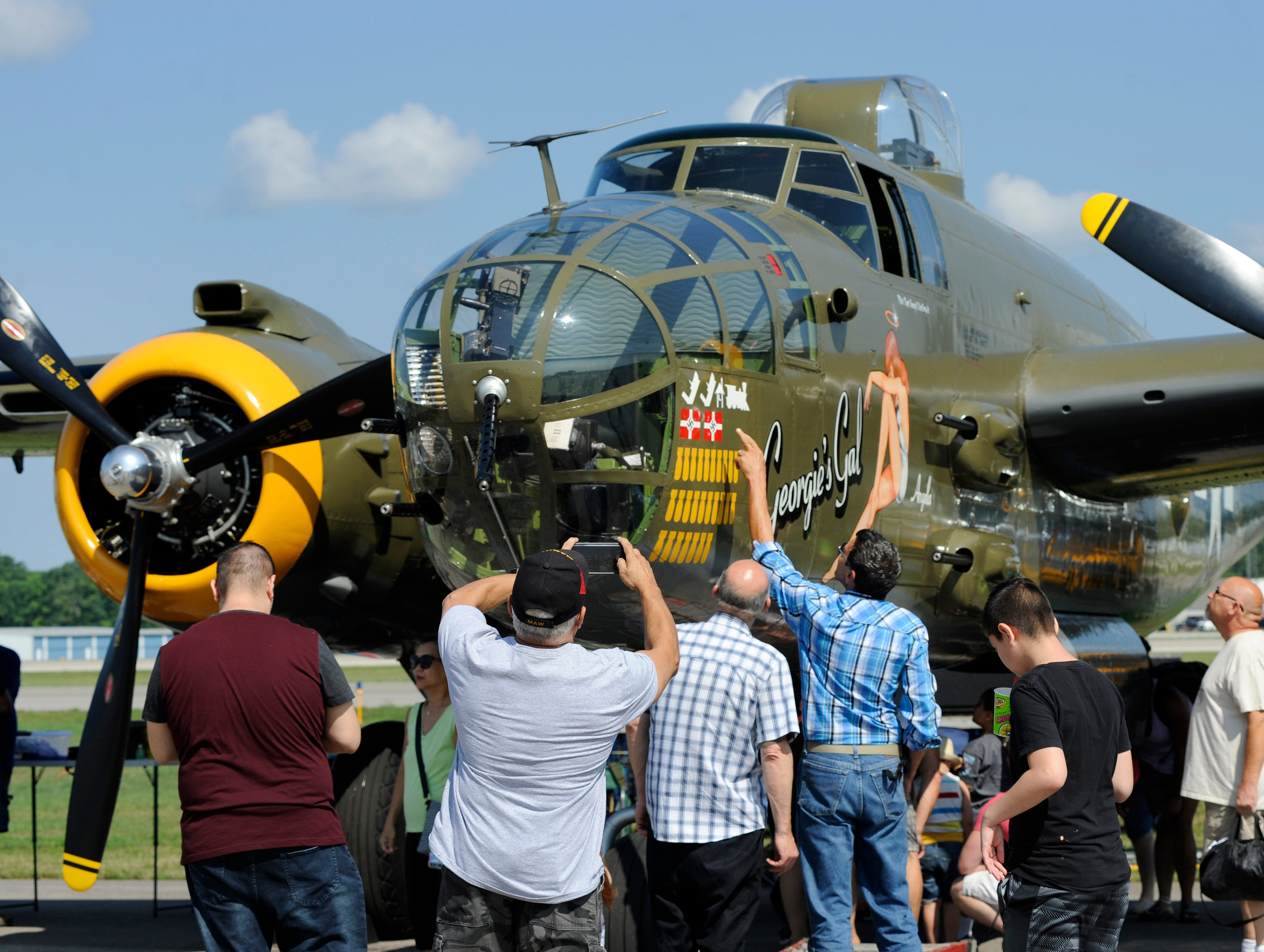 Visitors to the Air Show & Open House take pictures of Georgie's Gal, a World War II B-25J Mitchell Bomber.