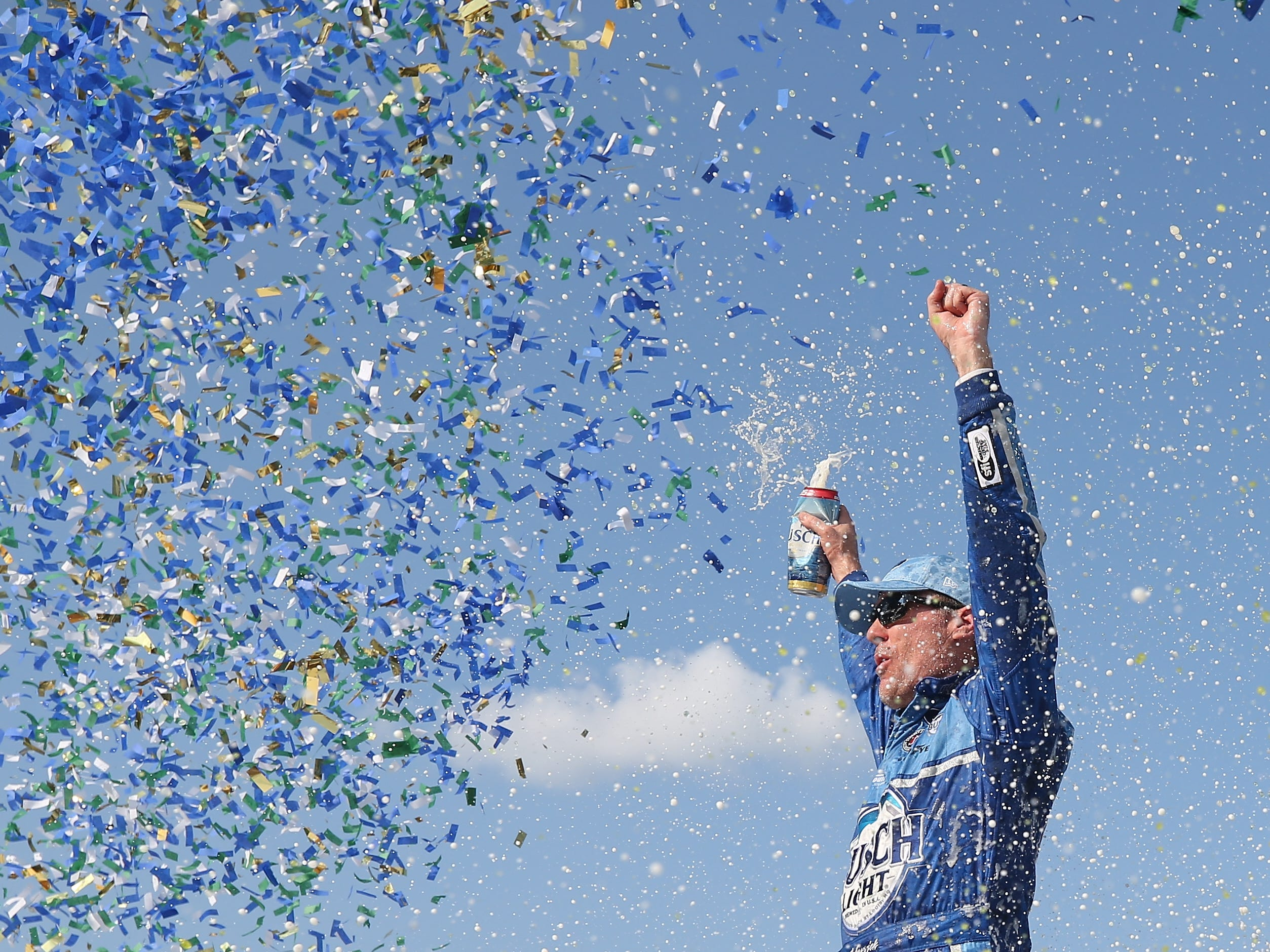 Kevin Harvick, driver of the #4 Busch Light/Mobil 1 Ford, celebrates in Victory Lane after winning the Monster Energy NASCAR Cup Series Consmers Energy 400 at Michigan International Speedway on August 12, 2018 in Brooklyn, Michigan.