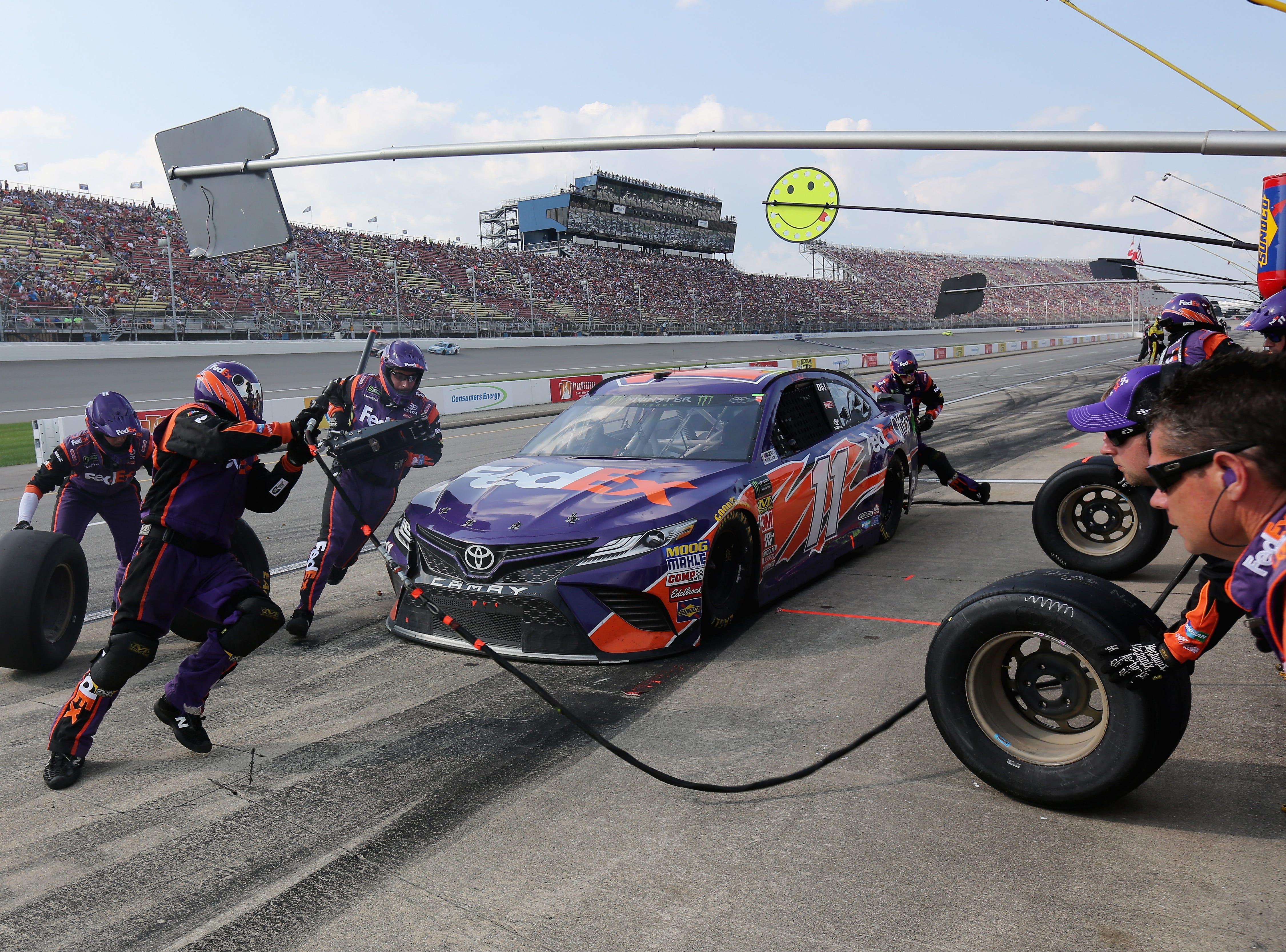 Denny Hamlin, driver of the #11 FedEx Office Toyota, pits  during the Monster Energy NASCAR Cup Series Consmers Energy 400 at Michigan International Speedway.