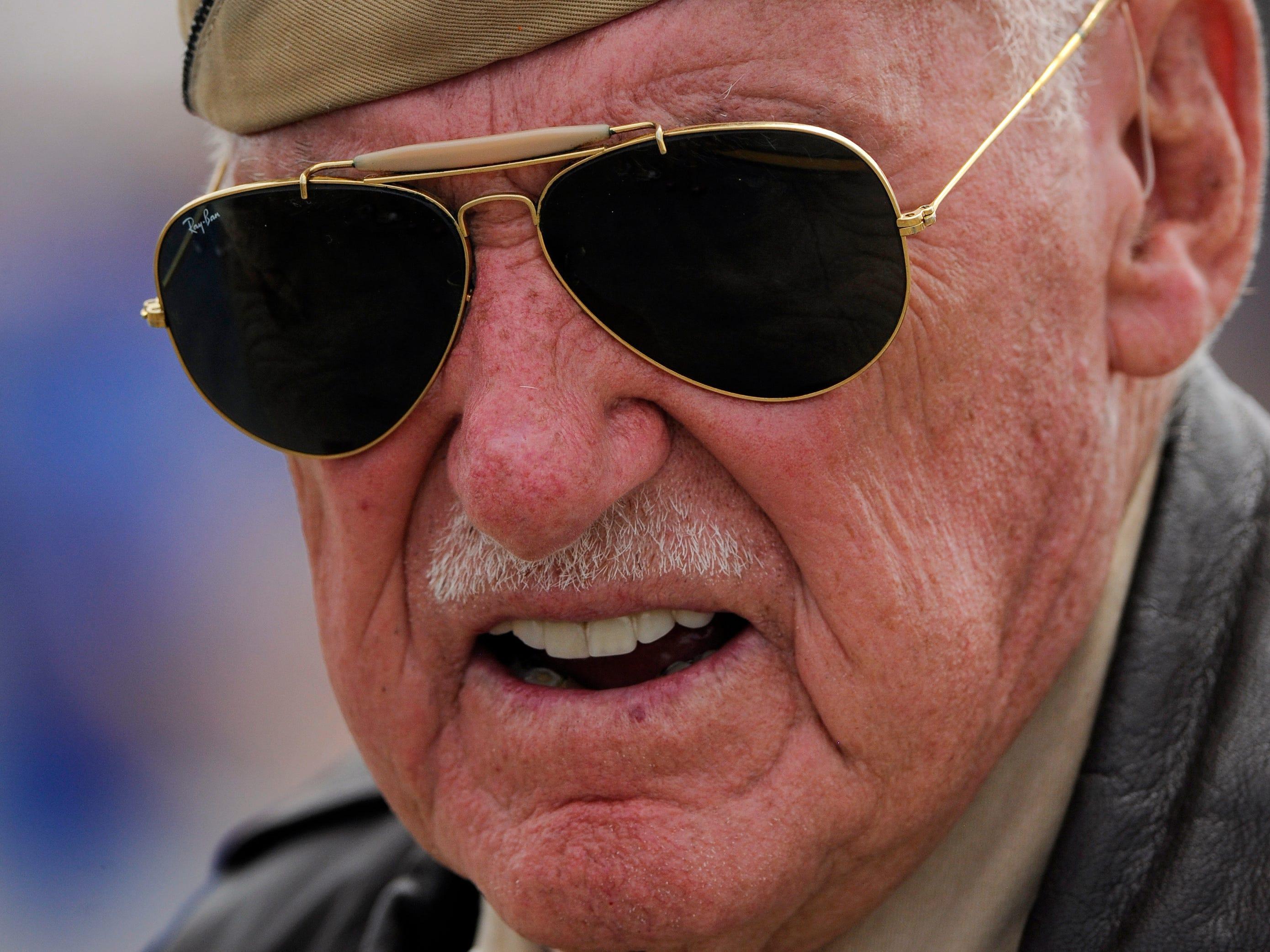 World War II army veteran Richard Pilon of Burton watches the Air Show & Open House.