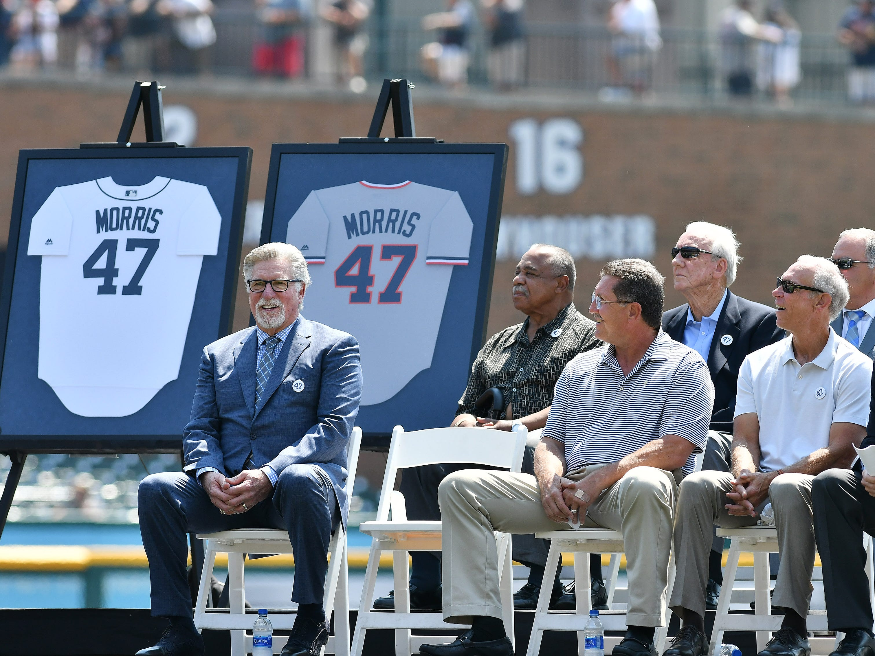 Jack Morris,left, listens while a teammate from 1984 talks about Morris' legacy during the special pregame ceremony.