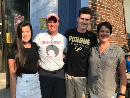 Sean English with his family -- sister Meghan, father Sean Sr. and mother Peggy -- during Saturday's college fundraiser in Ferndale.