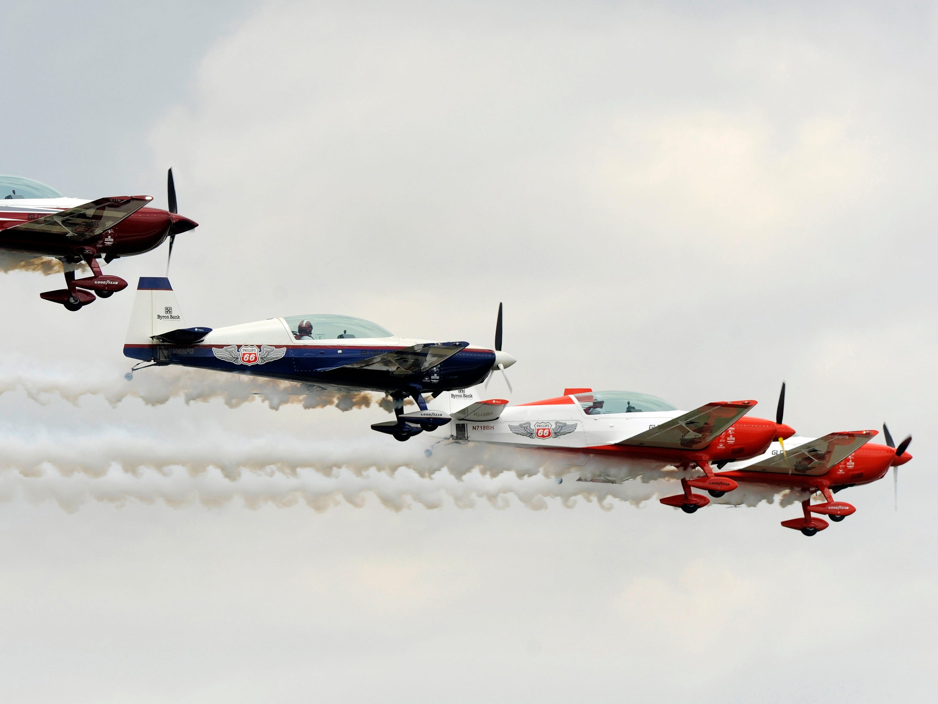 The Phillips 66 Aerostars team fly in formation during the Air Show & Open House.