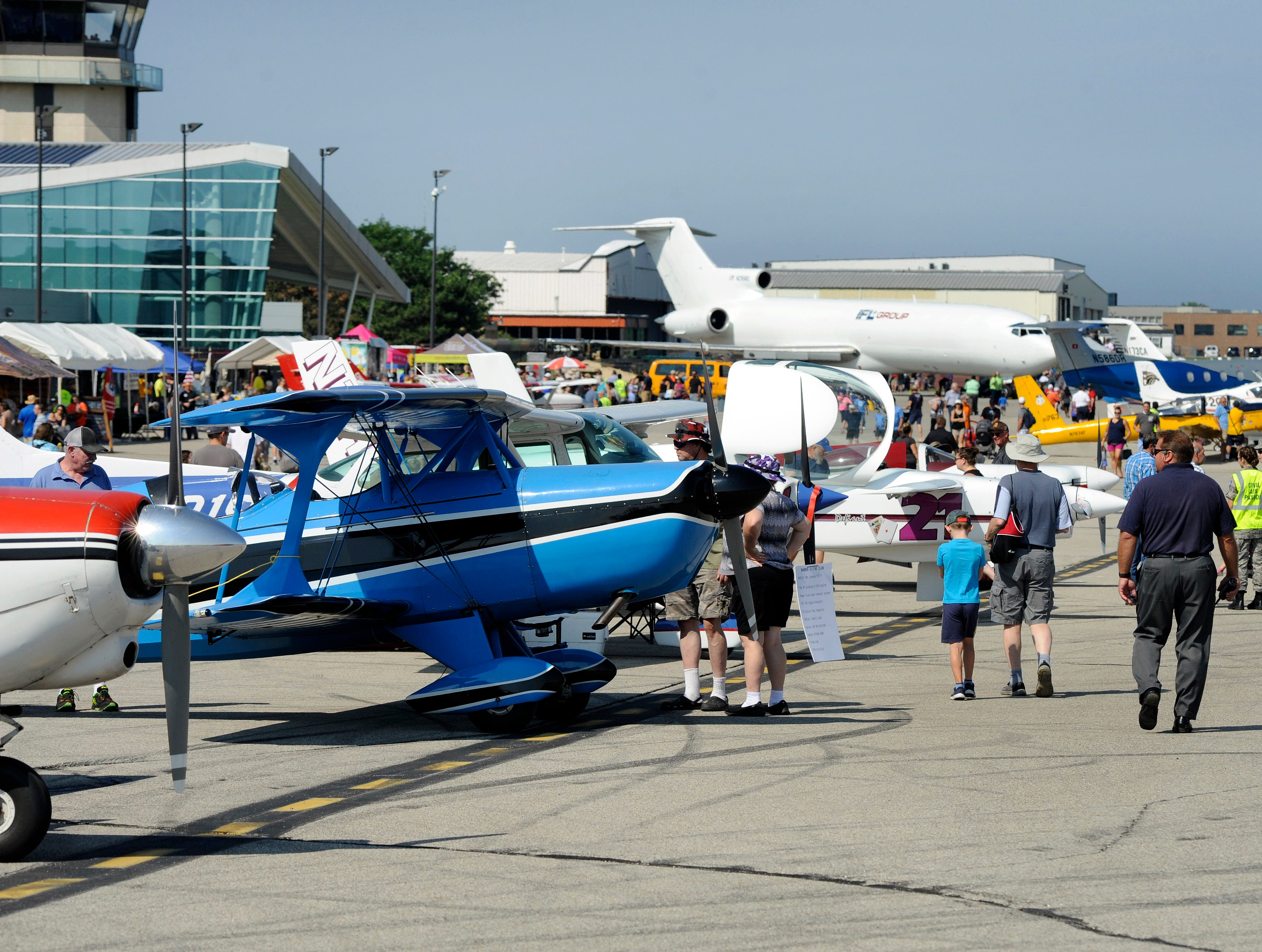 Visitors to the Air Show & Open House look over various aircraft.