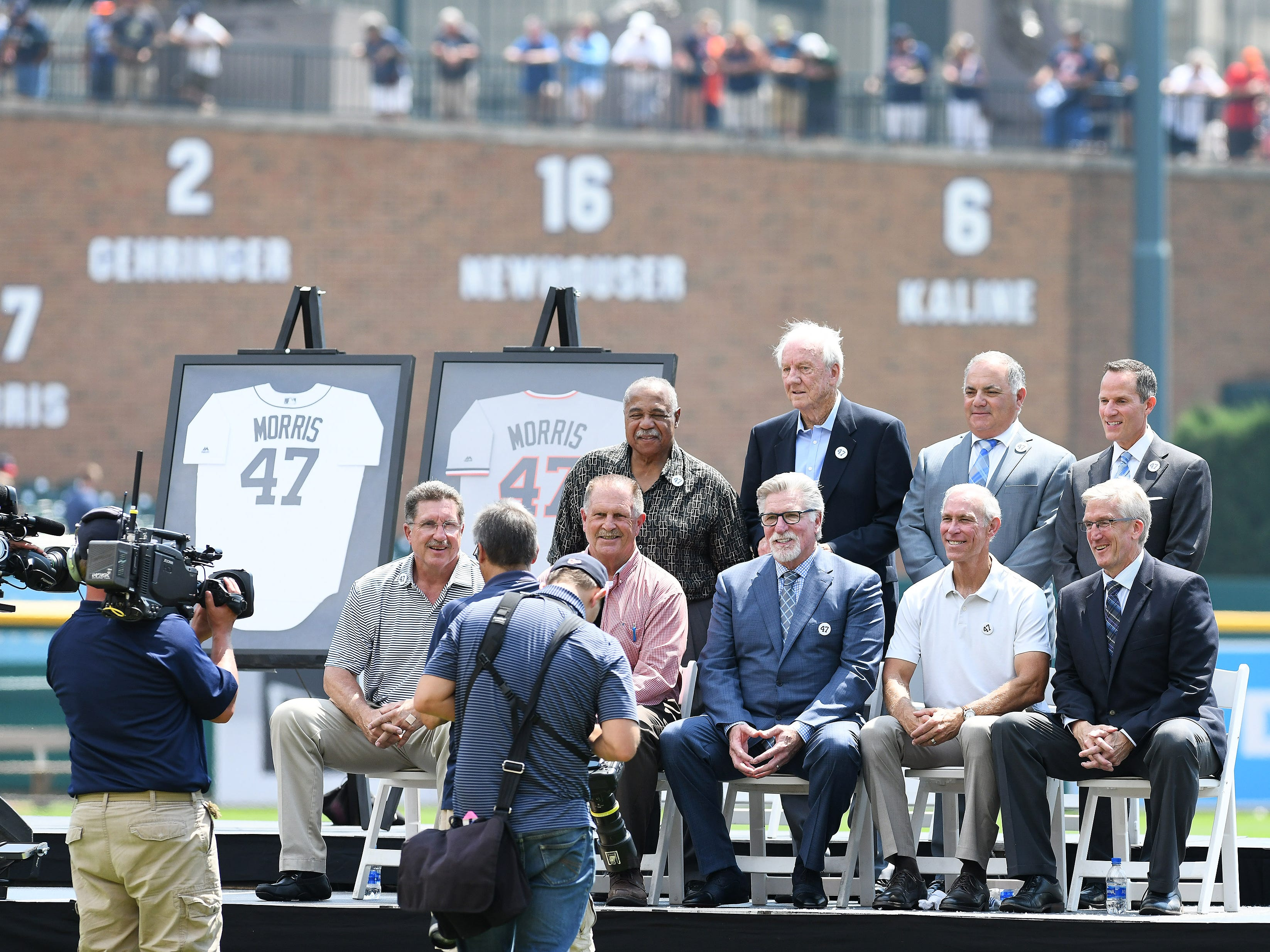Photographers get a group photo of the dignitaries on the stage with Jack Morris, center seated, after the special pregame ceremony.