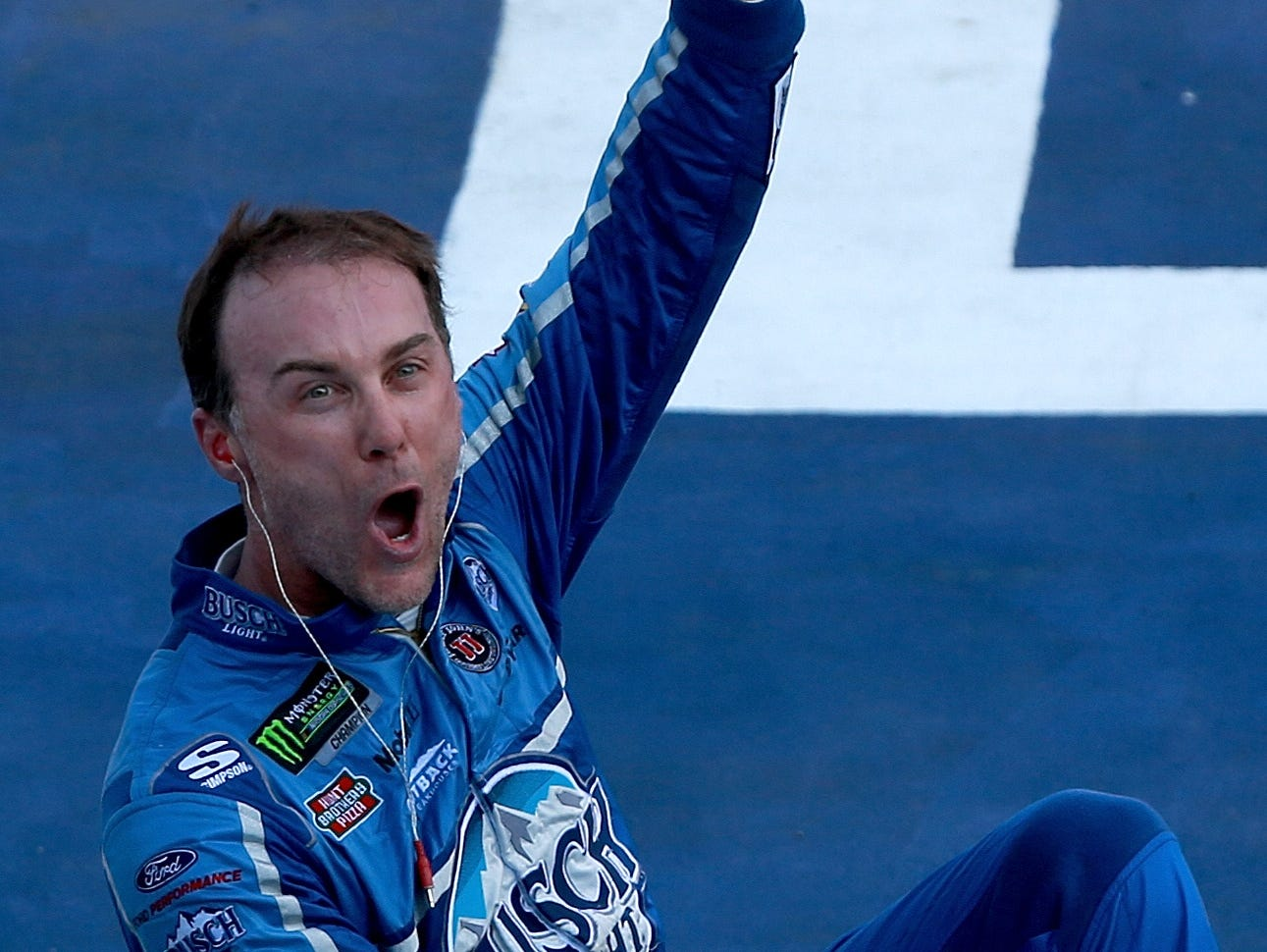 Kevin Harvick, driver of the #4 Busch Light/Mobil 1 Ford, celebrates after winning the Monster Energy NASCAR Cup Series Consmers Energy 400 at Michigan International Speedway.