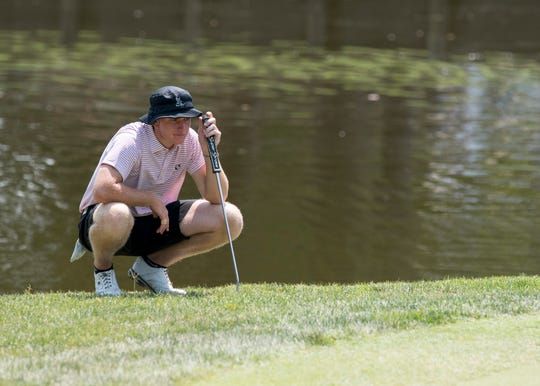 Stewie Hobgood eyes the putt on the 15th hole during the final round of the Courier & Press Men's City Golf Tournament at the Evansville Country Club on Sunday afternoon. Hobgood shot a 278 overall making him the 2018 champion.