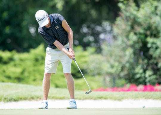 Adam Bratton watches his ball after making a putt on the  14th hole during the final round of the Courier & Press Men's City Golf Tournament at the Evansville Country Club on Sunday afternoon. Bratton shot a 280 overall making him the second place winner.