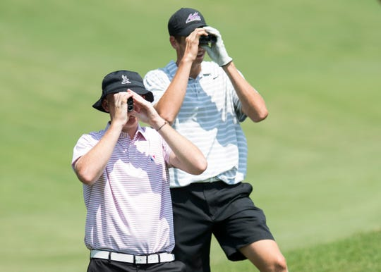 Stewie Hobgood, front, and Matthew Ladd surveys the 10th hole during the final round of the Courier & Press Men's City Golf Tournament at the Evansville Country Club on Sunday afternoon.