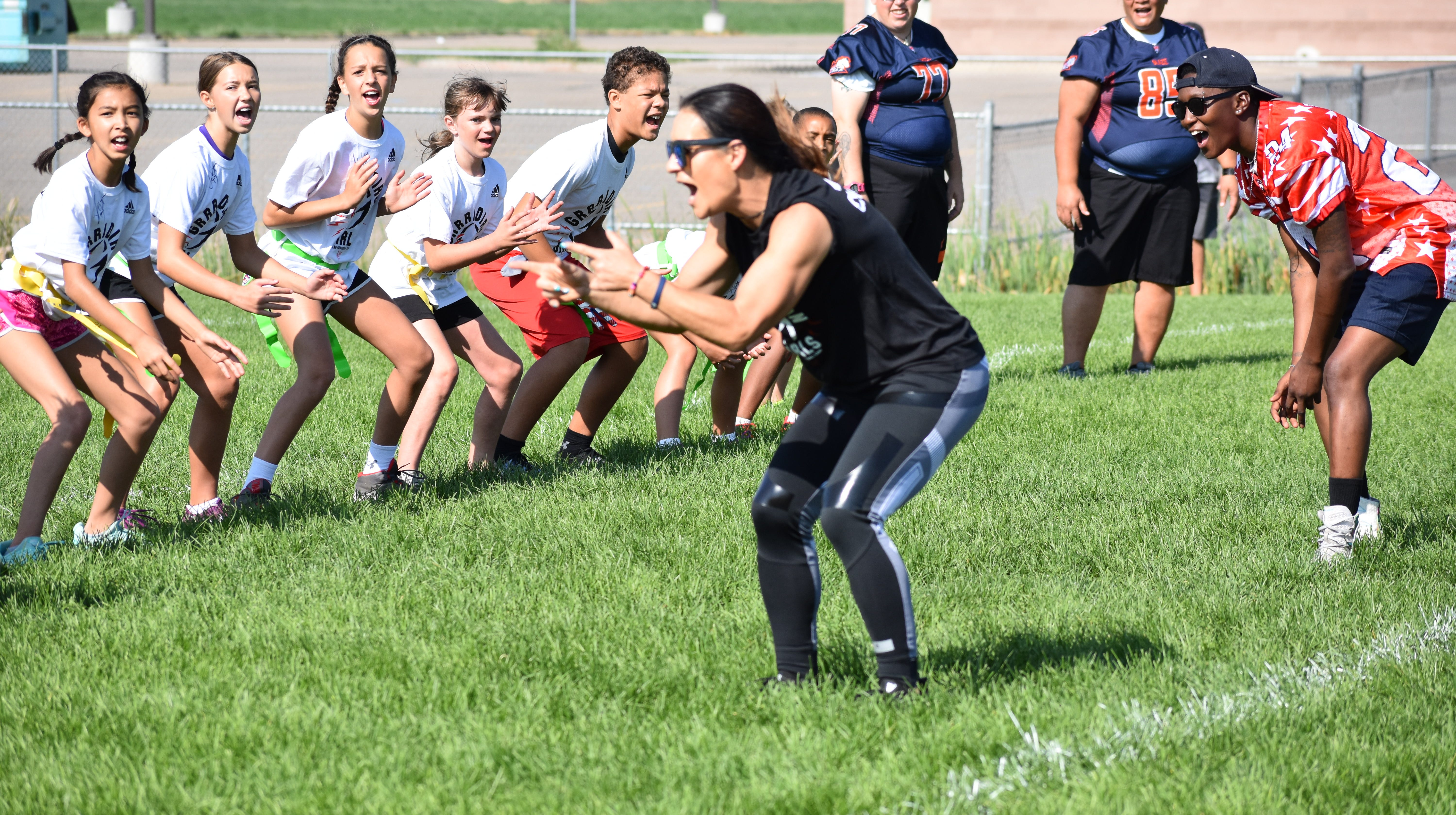 Local girls learn football skills at camp run by NFL's first female assistant coach