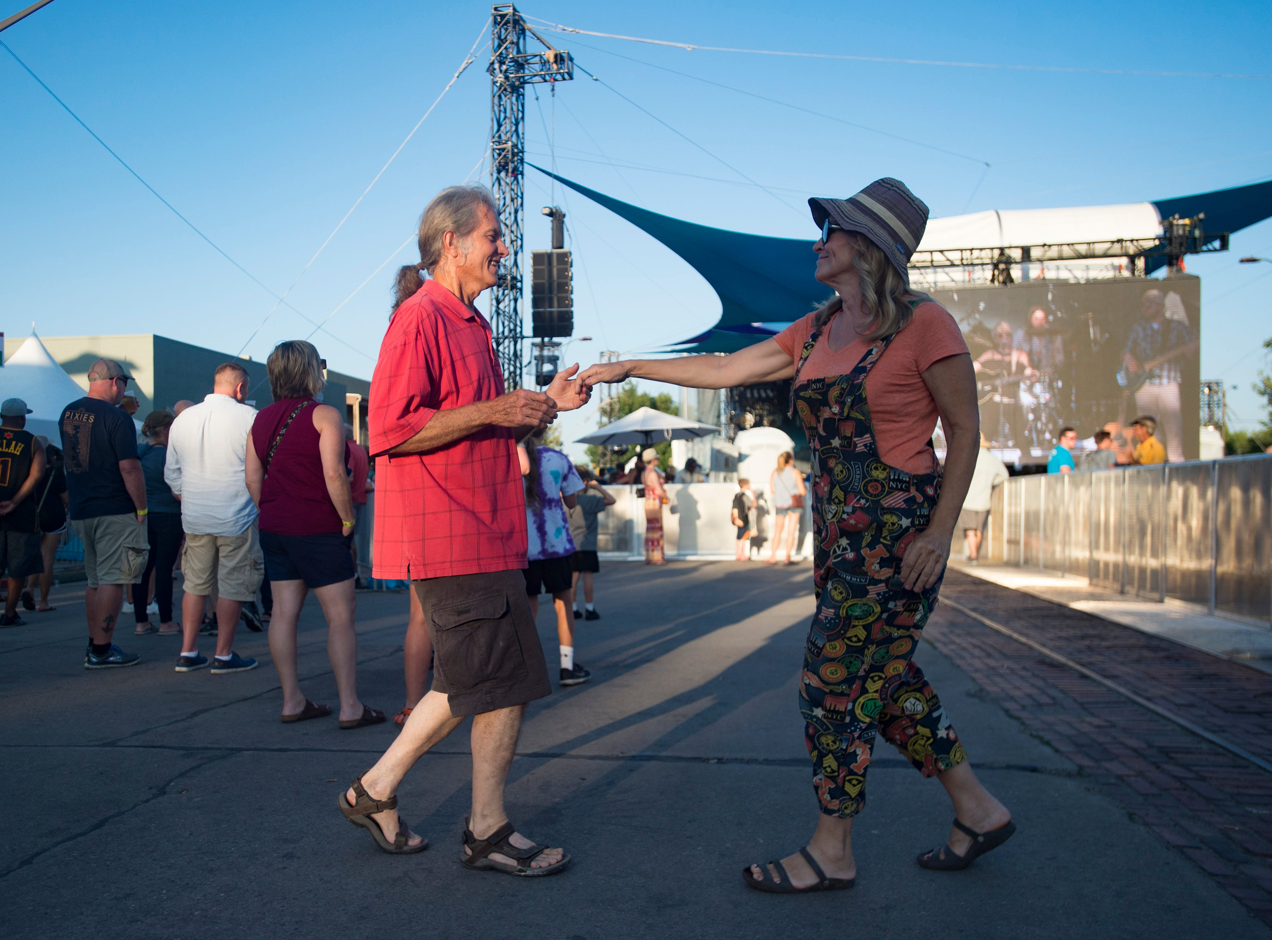 Les Sunde and Maria Singleton dance along to The Patti Fiasco at the Mountain Avenue Stage during Bohemian Nights at NewWestFest in Old Town on Saturday, August 11, 2018.