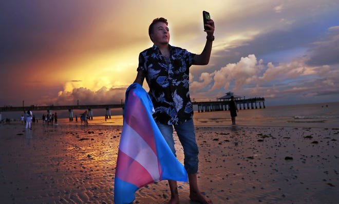 Kasey Fraize, 20, enjoys a recent sunset on Fort Myers Beach. Fraize, a transgender man from New Port Richey, always identified with masculine things but waited until he started college at FGCU to start hormone replacement therapy.
