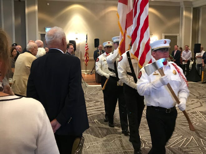 Members of the Fort Myers Beach Fire Department Honor Guard present the colors during the 8th annual Spirit of '45 ceremony Sunday.