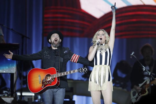 """Kristian Bush, left, and Jennifer Nettles opened their Resch Center show on Saturday with the title track off their new album, """"Bigger."""""""