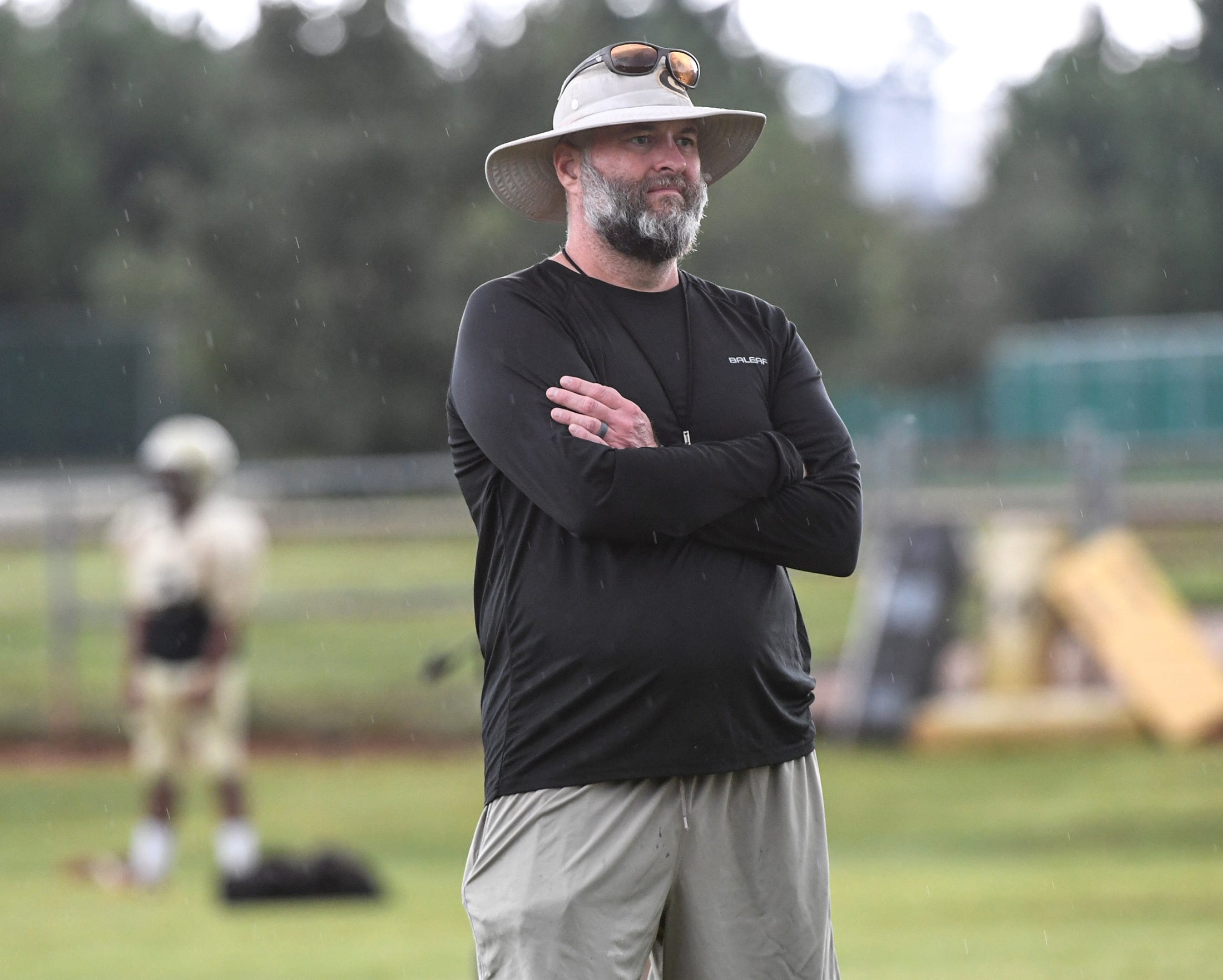 Greer head football coach Will Young watches players during practice in Greer in August. Will Young continues coaching after successfully getting a kidney donation from wife Michelle.