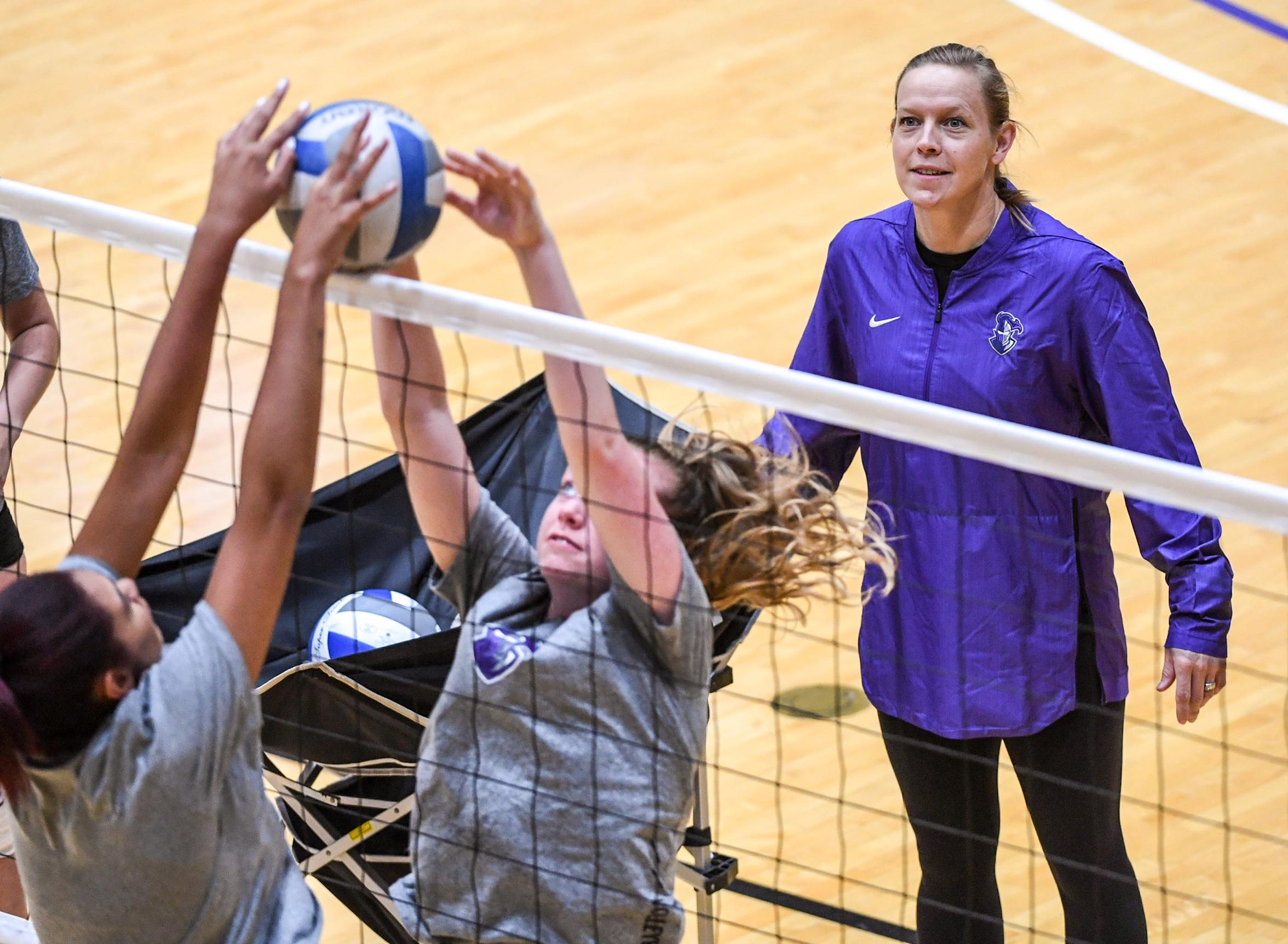 Michelle Young, Furman University volleyball coach, leads a practice at the school in Greenville on Thursday. She donated one of her kidneys to her husband Will Young, the Greer High School football coach.