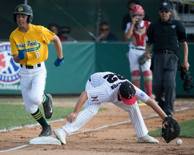 Ryan Knaebel of Michigan hustles out a play at first that was dropped by Blaine Hamilton of the Indiana squad, during Michigan's 13-0 victory in the regional finals, Grand Park, Westfield, Saturday, Aug. 11, 2018. The Grosse Pointe squad will represent the Great Lakes region in the upcoming Little League World Series.