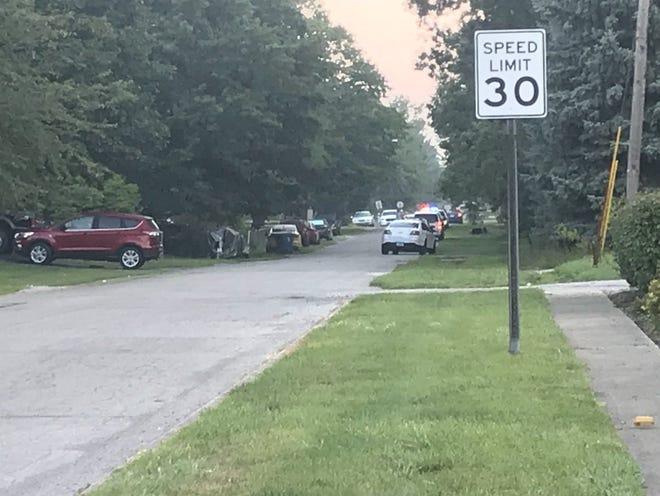 Police investigate a shooting in the 200 block of South Fenton Avenue on Sunday.