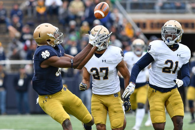 Apr 21, 2018; Notre Dame, IN, USA; Notre Dame Fighting Irish wide receiver Miles Boykin (81) catches a pass in front of cornerback Julian Love (27) in the first quarter of the Blue-Gold Game at Notre Dame Stadium. Mandatory Credit: Matt Cashore-USA TODAY Sports