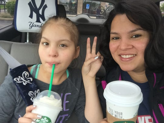 Belinda Velasquez and her daughter Athena, who is in remission after two years battling leukemia.