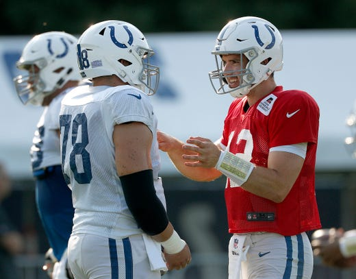 Indianapolis Colts quarterback Andrew Luck (12) talks with his center Ryan Kelly (78)  during their preseason training camp at Grand Park in Westfield on Sunday, August 12, 2018.