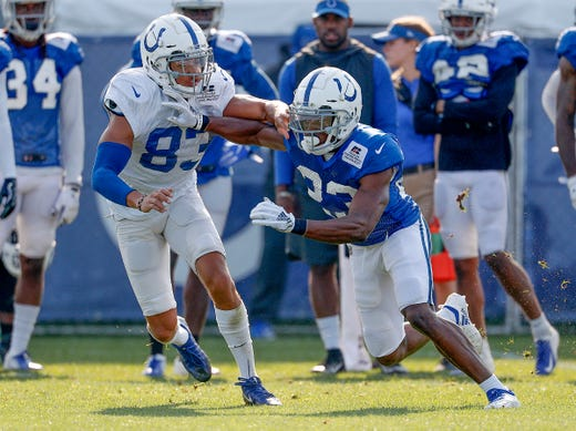 Indianapolis Colts Kenny Moore (23) runs on Dres Anderson (83)  work on a special teams drills during their preseason training camp at Grand Park in Westfield on Sunday, August 12, 2018.