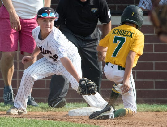 Landon Gum can't get the tag in for Indiana as JJ Schoeck slides safely into third for Michigan, during Michigan's 13-0 victory in the regional final, Grand Park, Westfield, Saturday, Aug. 11, 2018. The Grosse Pointe squad will represent the Great Lakes region in the upcoming Little League World Series.