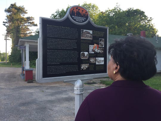 Reena Evers-Everette, the daughter of slain civil rights activist Medgar Evers, reads the Emmett Till marker.