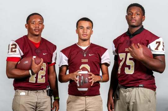Doss Dragons LEFT TO RIGHT: Quion Lee, senior, linebacker/running back, Rayshawn Nelson, senior, quarterback, Ricky Barber, senior, defensive end/defensive tackle.