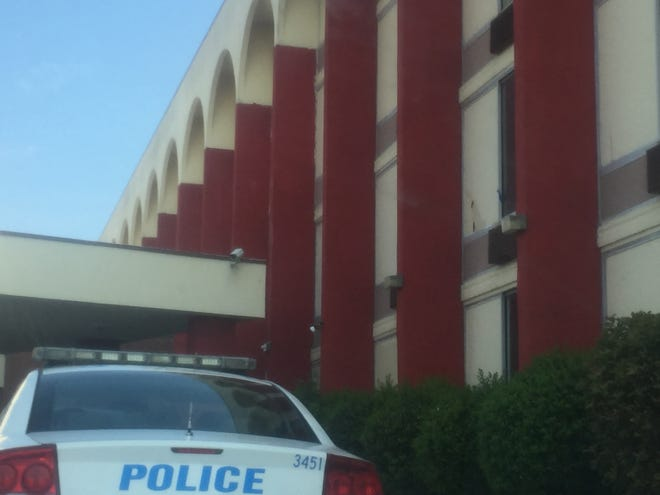 Memphis police investigate a shooting at the Real Value Inn Sunday morning.