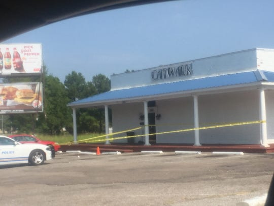 Crime tape surrounded the entrance of Catwalk of Memphis club on Lamar Avenue. Some involved with the Real Value Inn shooting fled there.