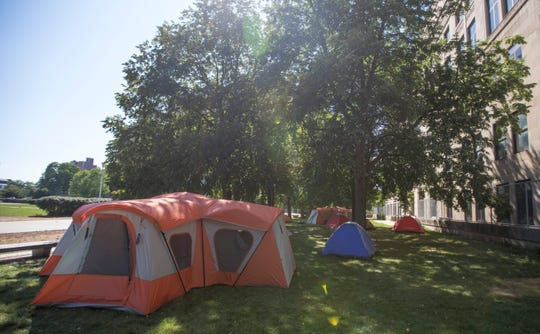 Tents are set out at MacArthur Square. Many of the people in the camp keep each other company and make it into a home as best as they can. Many of the tents are provided by advocacy groups, along with clothes and food.