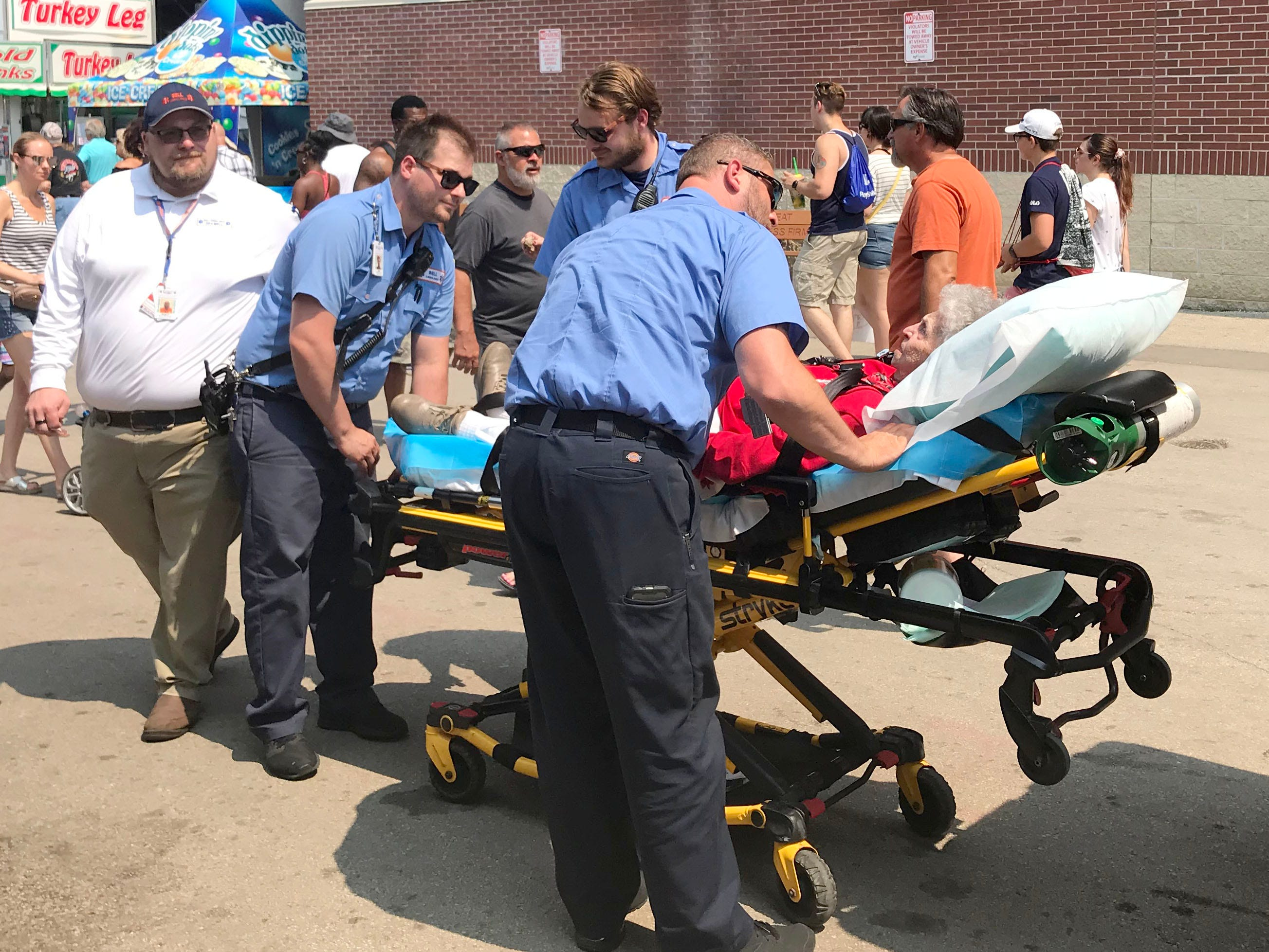 Bell Ambulance paramedics help Catherine Krause at the Wisconsin State Fair Sunday afternoon.