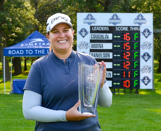 Lauren Coughlin poses with her trophy after winning the Symetra Tour's PHC Classic at Brown Deer Park Golf Course.