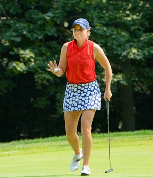 Casey Danielson acknowledges the applause from the gallery after sinking a birdie putt on the 13th hole during the final round of the Symetra Tour's PHC Classic.