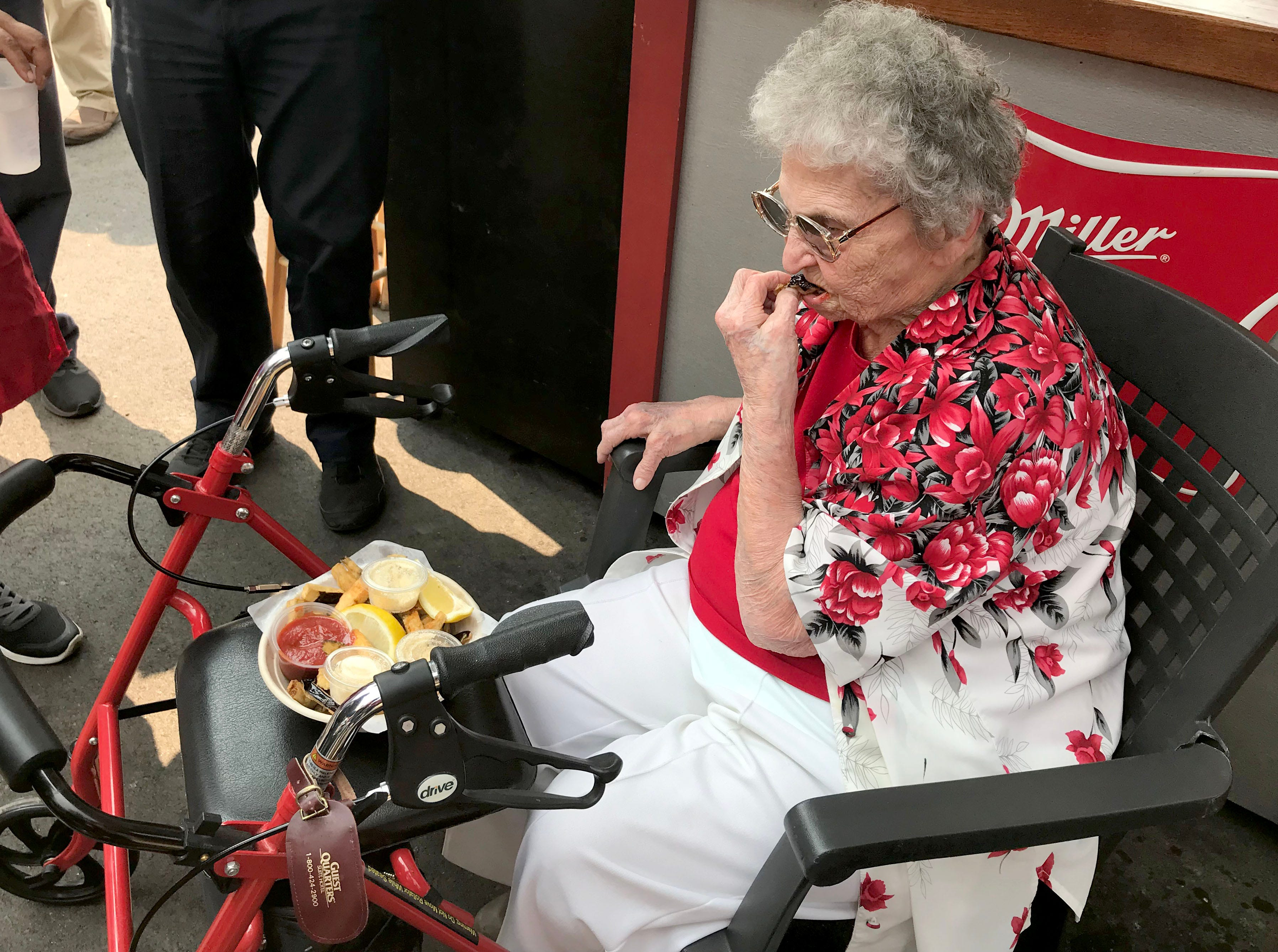 Catherine Krause, 100, snacks on her favorite, egg plant strips, at the Wisconsin State Fair.