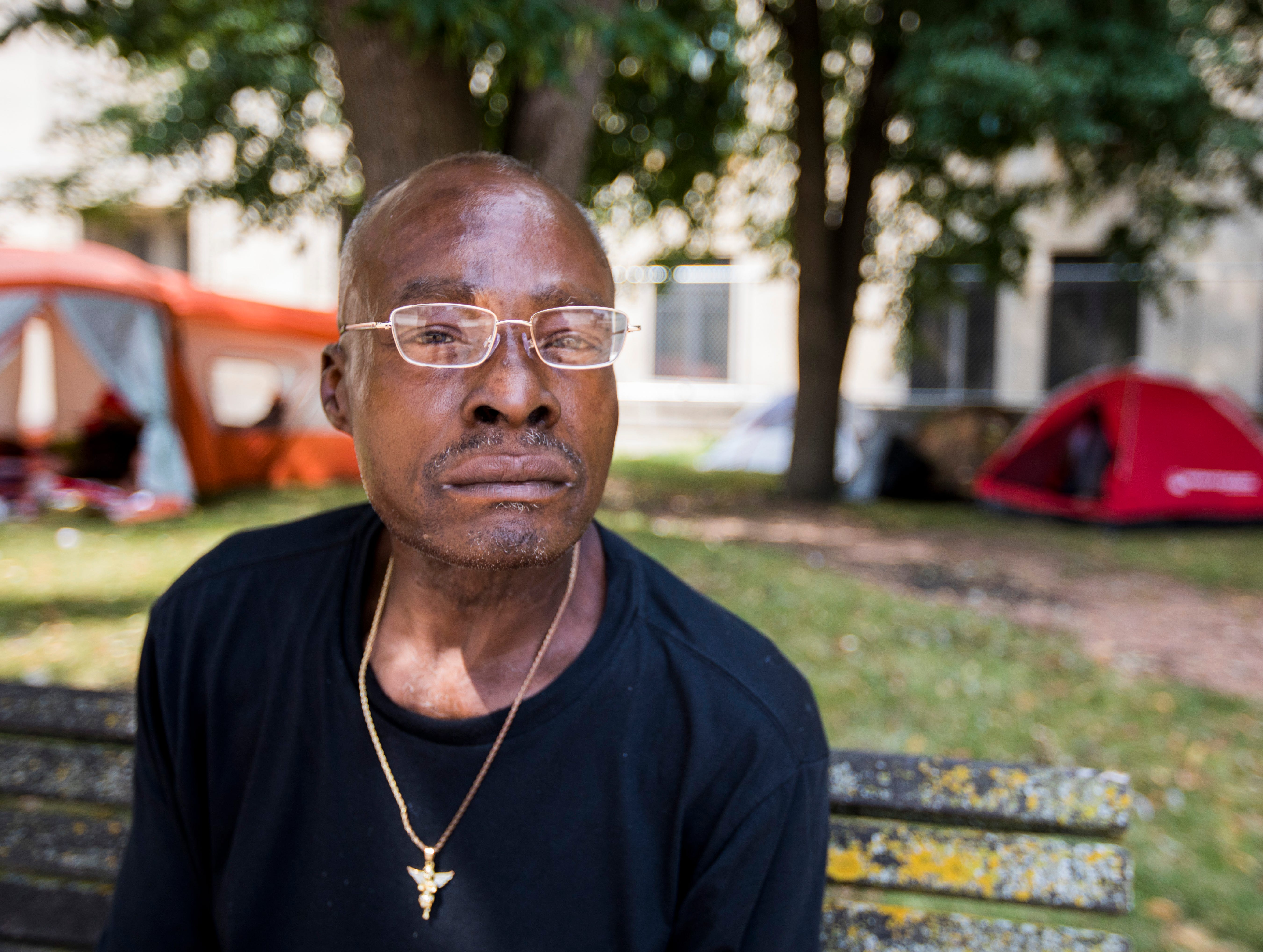 Gregory Richmond, 59, a Marine Corps veteran who served during 1979-'81, has been around Milwaukee for about 37 years and has been at the camp at MacArthur Square for about five months. Richmond wears a gold angel around his neck that he says represents the guardian angels who help and watch over him.