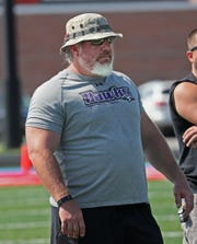 Kenosha Indian Trail coach Paul Hoffman watches his team play during a scrimmage at Arrowhead High School Friday Aug. 10, 2018.