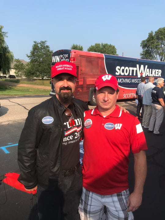"""Anthony Kizewski (left) and Kevin Clendenning attend a rally for a Gov. Scott Walker in Plover on Saturday. Kizewski, a potato and soy bean farmer and Trump backer, says the Trump tariffs will cause """"a little bit of pain"""" in the short run """"but in the long term it will provide more trade, absolutely."""""""