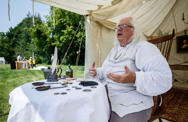 Re-enactor Terry R. Kutz of New Berlin chats with visitors as Dr. Benjamin Franklin during the Heritage Weekend living history event in Lisbon Community Park on Saturday, August 11, 2018. The town is ending the festival and has plans to replace it.