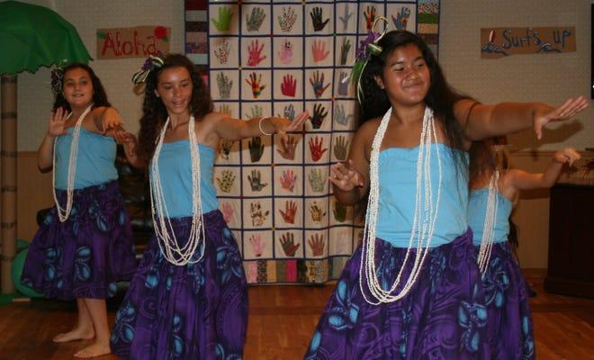 Malia Polynesian Ohana performers (from left) Jaylin Hodges, Emma Davenport and Bradlynn Davenport perform the hula as part of their performance for the residents of the Good Samaritan Society.