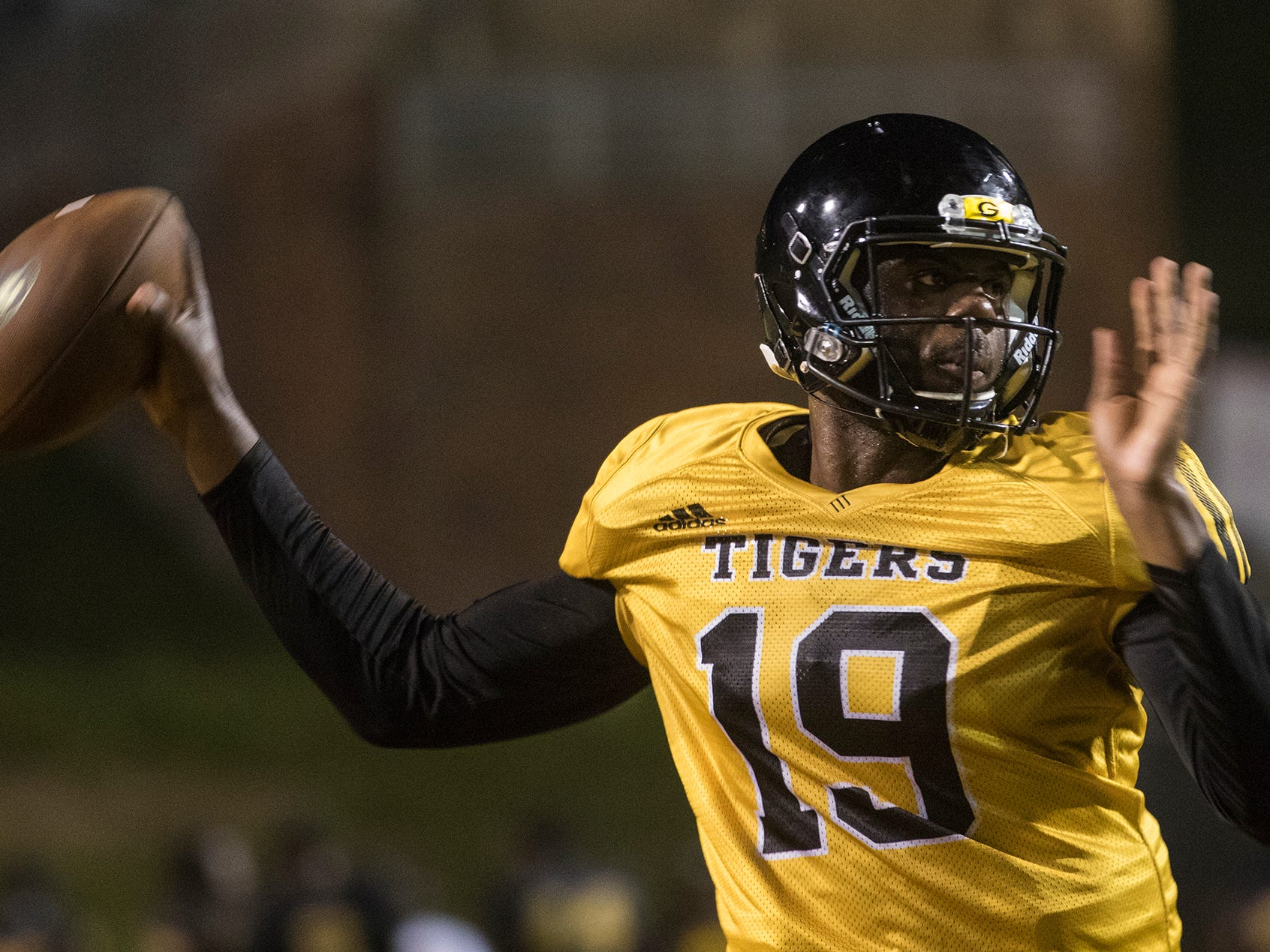 Quarterback Geremy Hickbottom (19) gets set to throw the ball during Grambling State University's practice on August 11 at Eddie Robinson Stadium in Grambling, La.