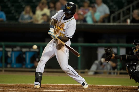 Biscuits outfielder Jesus Sanchez (15) hits the ball against the Birmingham Barons at Riverwalk Stadium in Montgomery, Ala., on Saturday, Aug. 11, 2018.