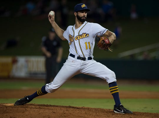 Biscuits pitcher Benton Moss (11) pitches against the Birmingham Barons at Riverwalk Stadium in Montgomery, Ala., on Saturday, Aug. 11, 2018.