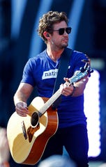 Brandon Lay performs during a concert at Nissan Stadium Saturday, Aug. 11, 2018 in Nashville, Tenn.