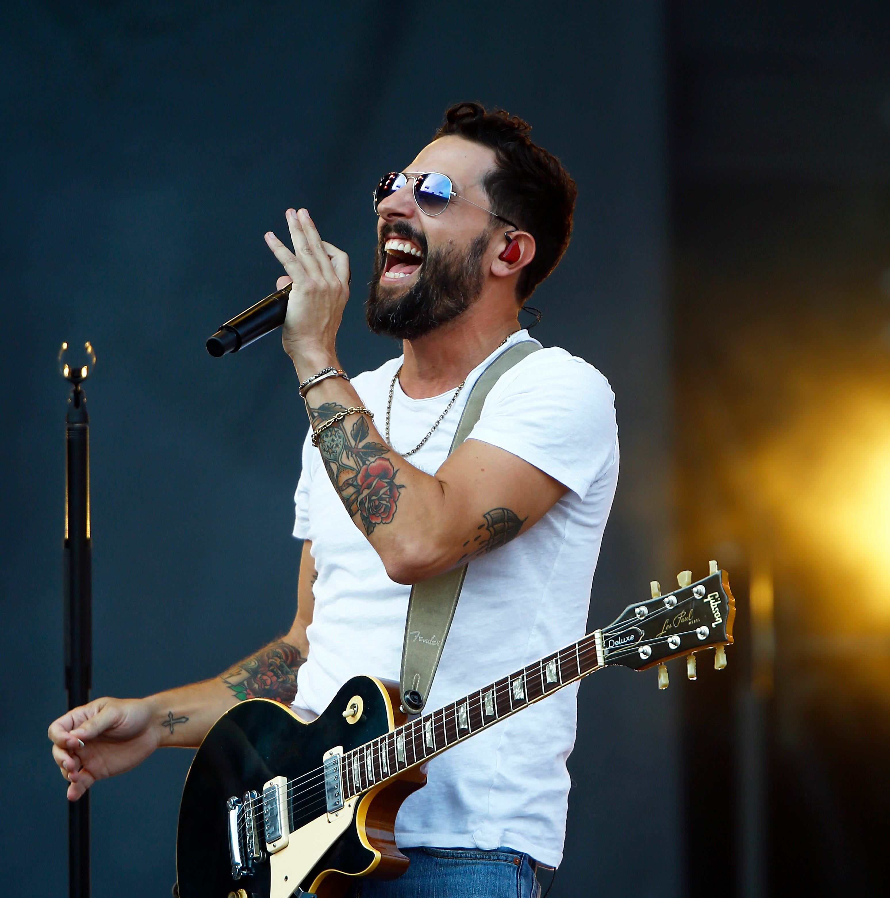 Matthew Ramsey, lead singer of the band Old Dominion performs during a concert at Nissan Stadium Saturday, Aug. 11, 2018 in Nashville, Tenn.