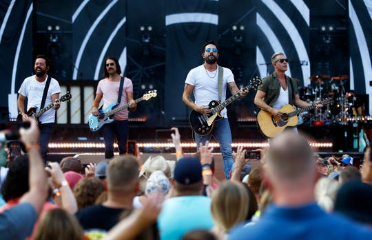 Matthew Ramsey third from the left, along with band members Trevor Rosen, Whit Sellers, Geoff Sprung, Brad Tursi of Old Dominion perform during a concert at Nissan Stadium Saturday, Aug. 11, 2018 in Nashville, Tenn.