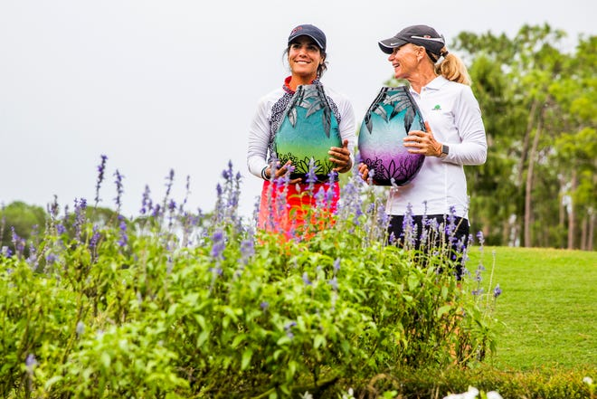 Women's Open winner Sandra Angulo Minarro, left, and Senior Open winner Mary Jane Hiestand with their trophies after the Florida Women's Open and Senior Open at the Quail Creek Country Club and Golf Course on Sunday, Aug. 12, 2018.